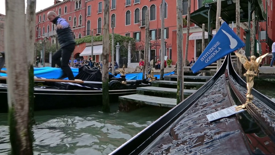 Float in a gondola down the Venice canals